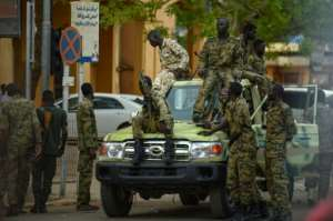 Sudanese army soldiers deploy in front of the presidential palace in downtown Khartoum.  By MOHAMED EL-SHAHED (AFP)