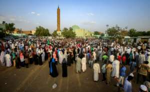 Sudanese celebrate in Khartoum after protest leaders struck a power-sharing deal with the ruling generals.  By ASHRAF SHAZLY (AFP)