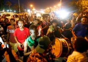 Sudanese celebrate on the streets as word spreads in the early hours of the hard-won deal between protest leaders and the ruling generals.  By ASHRAF SHAZLY (AFP)