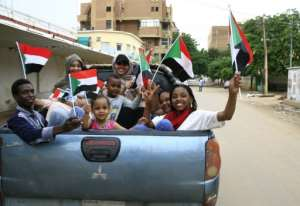Sudanese children take part in celebrations after protest leaders and generals signed a landmark agreement that will govern Sudan's three-year transition to civilian rule.  By Ebrahim HAMID (AFP)