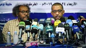 Sudanese civil society activists Muawia Shaddad (L) and Omar el-Digeir (R), two of the leaders from the protest movement led by the Alliance for Freedom and Change, give a press conference in the capital Khartoum on Wednesday. By OZAN KOSE (AFP)
