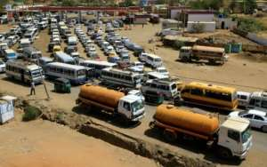 Sudanese motorists queue for as long as six hours to fill up, a heavy burden for the many who make their living from their vehicles.  By ASHRAF SHAZLY (AFP)