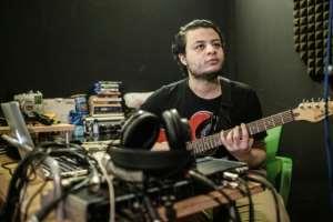 Sudanese music producer and guitarist Amjad Badr plays the guitar at Capital Radio in Khartoum.  By Yasuyoshi CHIBA (AFP)
