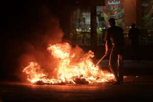 Sudanese protesters burn tyres on June 20, 2019 as demonstrations against the military council continued in Bahri, on the northern outskirts of Khartoum.  By - (AFP/File)