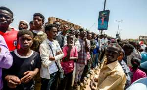 Sudanese protesters keep up their sit-in outside army headquarters in Khartoum for a seventh day demanding an immediate handover to civilian rule.  By MOHAMMED HEMMEAIDA (AFP)