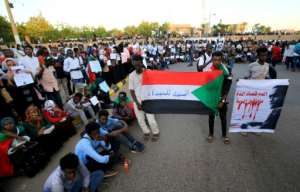 Sudanese protesters staged a demonstration on December 3, calling on authorities to deliver justice for those killed in demonstrations against the now ousted Bashir.  By ASHRAF SHAZLY (AFP/File)