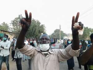 Sudanese protesters take part in an anti-government demonstration in Khartoum, as the government threatened legal action against the movement leaders.  By - (AFP)