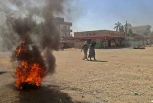 Sudanese protestors burn tyres during an anti-government demonstration on January 18, 2019 in the capital Khartoum.  By - (AFP)