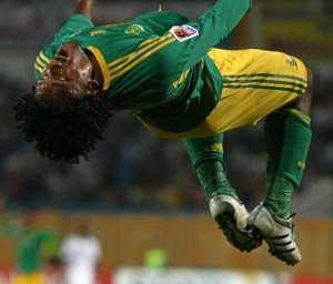 Kermit Erasmus flips in celebration.  By Cris Bouroncle (AFP/File)