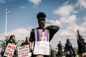 Support: A woman in Durban takes part in a march of solidarity with victims of gender violence.  By Rajesh JANTILAL (AFP)