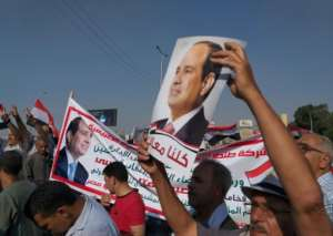 Supporters of Egyptian President Abdel Fattah al-Sisi rally near the Unknown Soldier Memorial in the eastern Nasr City.  By Khaled DESOUKI (AFP)