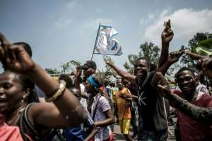 Supporters of Felix Tshisekedi celebrate after he was named winner of DR Congo's presidential election, while elsewhere supporters of Martin Fayulu took to the streets in protest.  By John WESSELS (AFP)