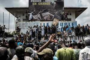 Supporters of Felix Tshisekedi, who was named provisional winner of Democratic Republic of Congo's presidential election, celebrate outside the Union for Democracy and Social Progress (UDPS) headquarters in Kinshasa on January 10, 2019.  By John WESSELS (AFP/File)