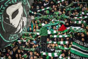 Supporters of Raja Club Athletic chant slogans and wave flags at a Moroccan football match between Raja and Mouloudia Oujda in January.  By FADEL SENNA (AFP)