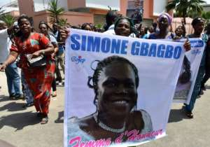 Supporters of Simone Gbagbo celebrated in front of her home in the upmarket district of Cocody. The former first lady and her husband, Laurent, retain enthusiastic support among part of the electorate.  By ISSOUF SANOGO (AFP)
