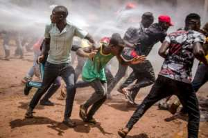 Supporters of Ugandan musician-turned-politician Bobi Wine were targeted by water cannon and tear gas shortly before his arrest on his way to a press conference.  By Badru KATUMBA (AFP)