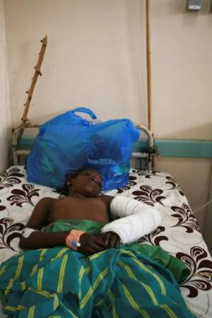 Survivor: A child is treated at a regional hospital for injuries she sustained in the attack. By Handout (MALIAN PRESIDENCY/AFP)