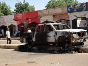 A pickup truck burnt by members of the Boko Haram Islamist sect in Damaturu.  By Aminu Abubakar (AFP/File)