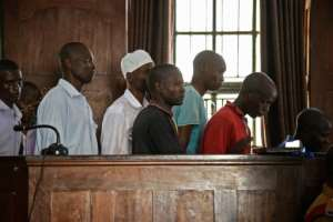 Suspects at the first hearing represented a cross-section of Ugandan society, from unemployed young men to a middle-aged university lecturer..  By Isaac KASAMANI (AFP/File)