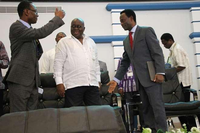 APOSTLE DR. OPOKU ONYINAH (R) AND THE GENERAL SECRETARY, APOSTLE KUMI-LARBI (L) INTERACTING WITH NANA ADDO