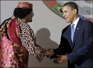 Obama, right and Moammar Gadhafi