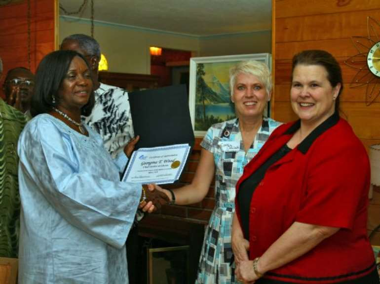 Chamber Chairwoman Bonnie Swanson and President Cynthia Oswald present Her Ladyship with a Certificate of Appreciation on behalf of the Livingston County Chamber of Commerce Board of Directors.