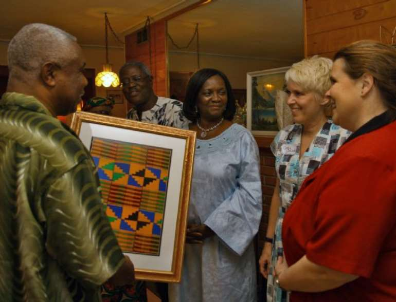 Honorable Justice, Victor Dotse, presents Chamber President Cynthia Oswald a gift of framed Kente Clothe on behalf of the Chief Justice and the Judicial Service of Ghana.