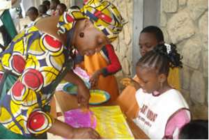 Dr. Layiwola with children at a workshop at the Institute of African Studies, Lagos.