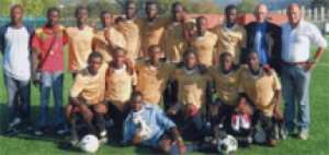 A group picture of Ghana Young Stars with their handlers