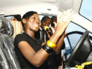 Bertha takes a ride in her car