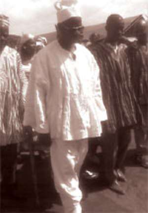 The newly installed Kusasi chief for the Asahiman community - Naaba Akum-Abang walking to take his seat at the ceremony. With him are some of his subjects