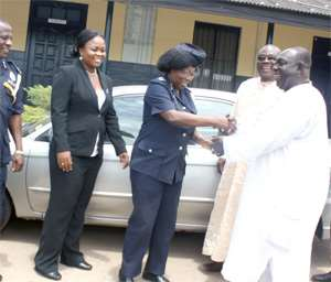 DCOP Rose Bio-Atinga receiving the keys to the vehicles from Kofi Appeaning yesterday