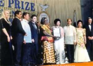 Mrs Chinery-Hesse (middle) with the officials of Gusi Foundation after receiving her award