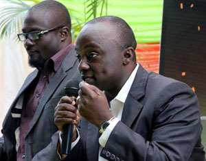 Nana Kwame Sarpong, GM of Yfm (left) and Ernest Boateng, MD, Global Media Alliance speaking at the press launch