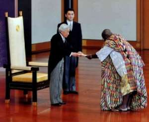 Dr. William George Mensah Brandful presenting his credentials to the Japanese Emperor Akihito