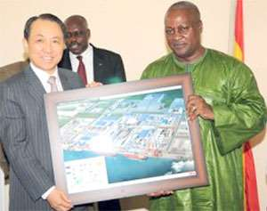 Flashback: Kang Duk-soo, Chairman of STX Group presents an artist's impression of the proposed houses to Vice President Mahama. Behind them is B.K. Asamoah