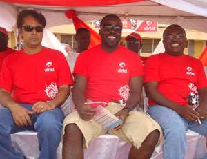 Samuel Osei Kufuor with some Airtel Ghana officials during the tournament.