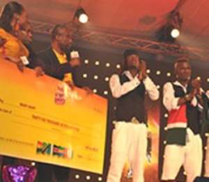 The Managing Director of GGBL, Mr. Ekwunife Okoli (3rd left) presenting the cheque for $36,000 to Wapi-Wapi Dance Crew from Kenya