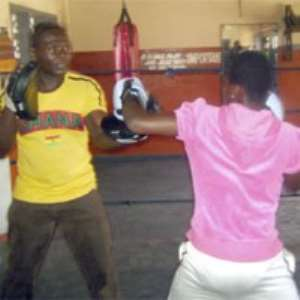 Lillian sparring with her dad at the Attoh Quarshie Gym