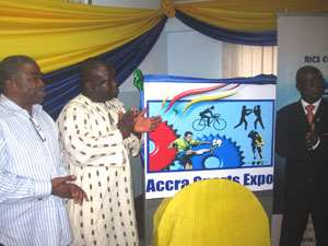 Rex Danquah (L) Ashigbey and Dr Owusu Ansah, Director of Sports, University of Ghana clap in admiration after unveiling the event's logo
