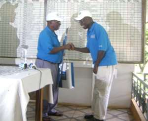 Poku in a hand shake with JS Addo