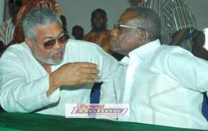 President Mills listening to the former President Rawlings at the NDC congress in Tamale.