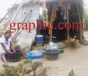 A makeshift structure erected by a resident of Joma whose house was demolished. INSET: Some children sleeping outside a tent put up after the demolition