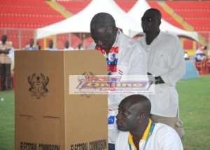 Former President J.A. Kufuor casting his ballot at the conference