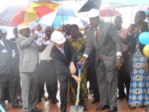 Prof. Ernest Aryeetey (right) and Naoto Nikai (left) breaking the ground for commencement of the project