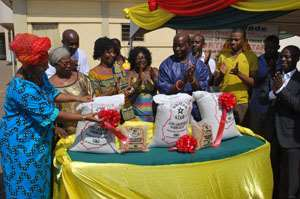 Mrs. Comfort Aniagyei (Left) being helped by other dignitaries at the ceremony to launch the Northern Star parboiled rice.
