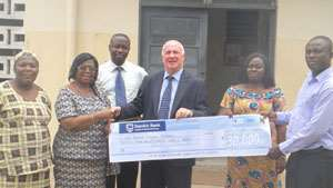 Mrs. Salome Francois in a handshake with Mr. Parker, after receiving the cheque