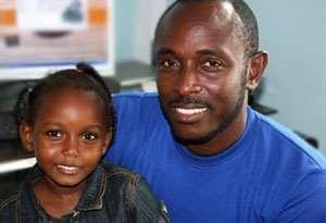 HAPPY TIMES: Godwin Nikoi Kotey with one of his kids
