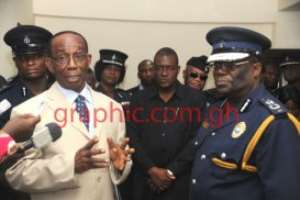 Mr William  Aboah, Interior Minster interacting with the IGP, Mr Paul Tawiah Quaye and other police officers during the Minister's visit to the Police Headquarters