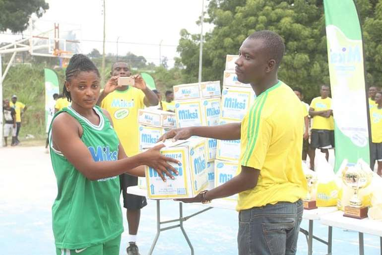 An official of Miksi presenting a product to one of the female players